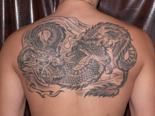 Angel With Dragon Tattoo On Shoulder photo - 3