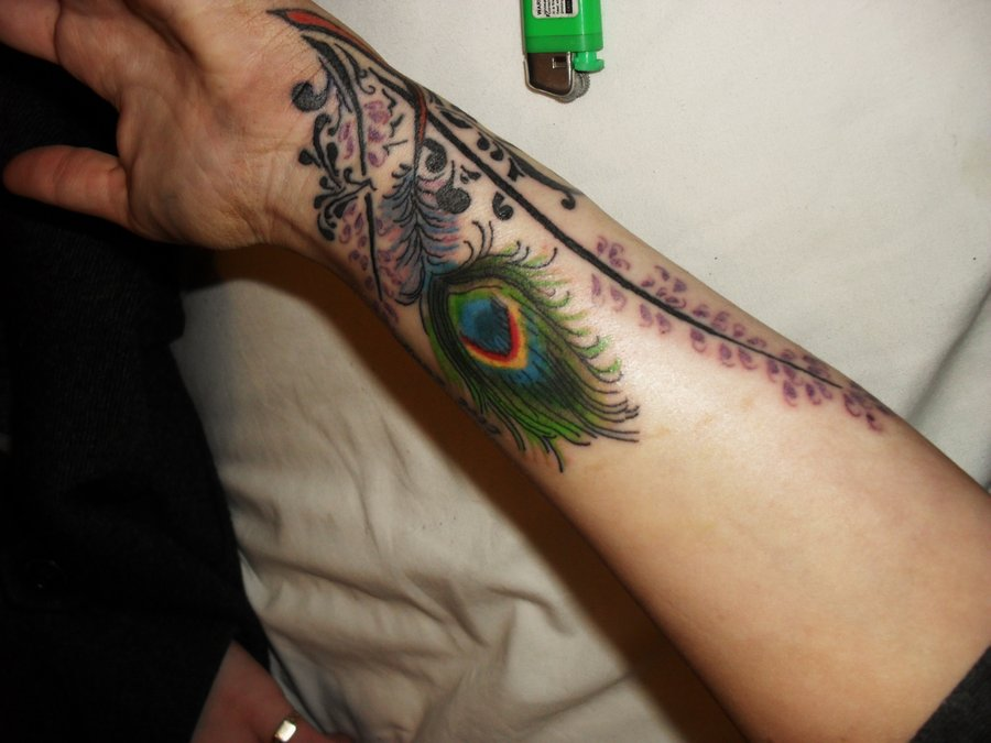 Awesome Peacock Feather Tattoo On Back photo - 1
