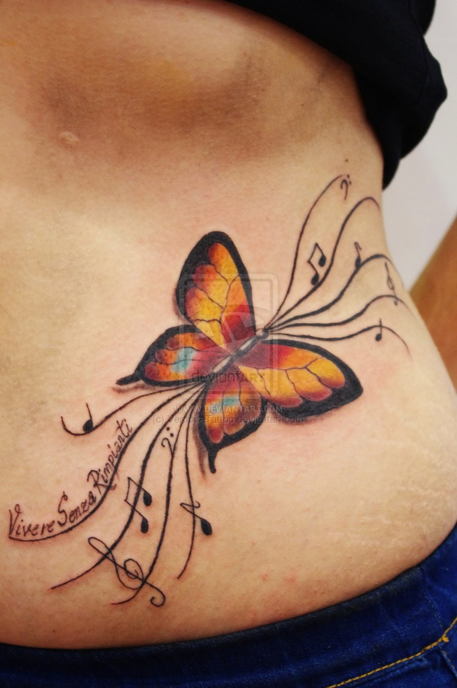 Awesome Small Butterfly Tattoo on Back of Body photo - 1