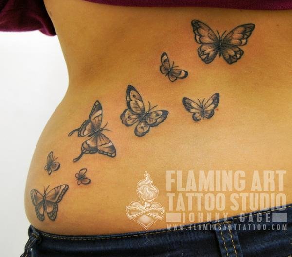 Awesome Small Butterfly Tattoo on Back of Body photo - 2