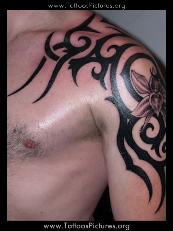 Awesome Tribal Tattoo On Right Shoulder photo - 1