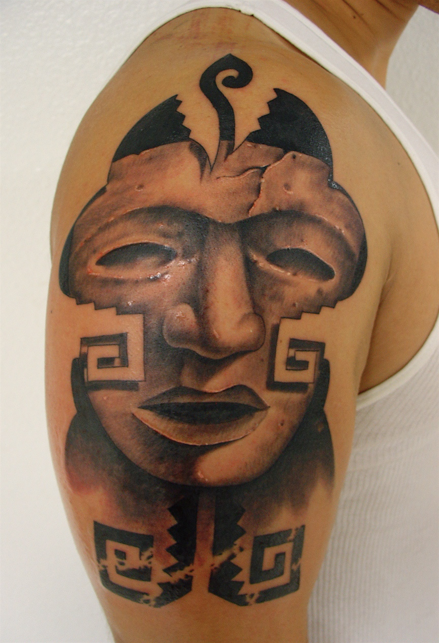 Aztec Face Tattoo on Bicep photo - 1