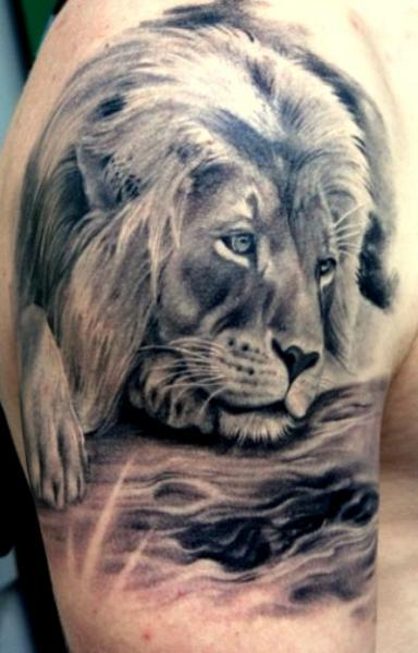 Best Lions Tattoo On Arm For Men photo - 3