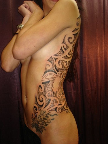 Big Tribal Horse Tattoo On Ribs photo - 2