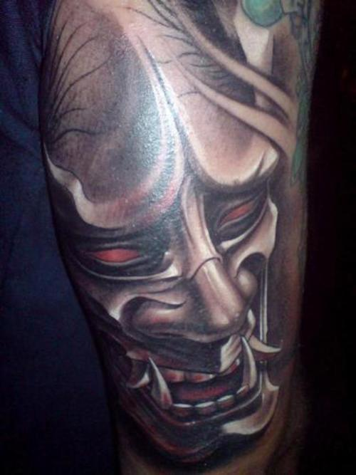Black And Grey Ink Hannya Mask Tattoo Design photo - 1