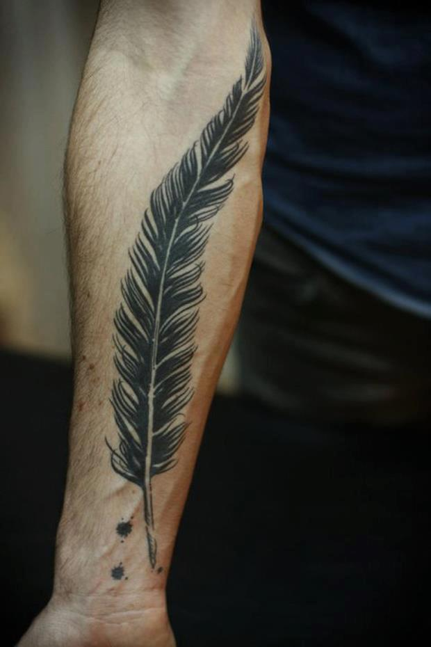Black And White Tribal Feather Tattoo On Forearm photo - 1