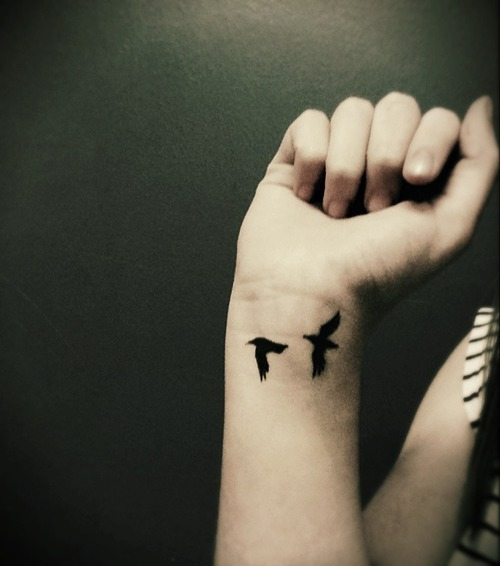 Black Birds Tattoos On Wrist photo - 3