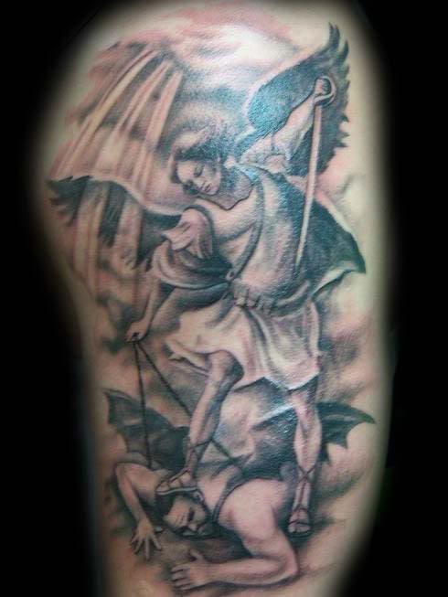 Black Ink Angel Word Tattoo On Arm photo - 1