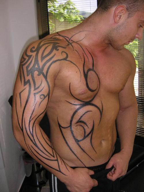 Black Ink Tribal Armband Tattoo On Muscles photo - 1