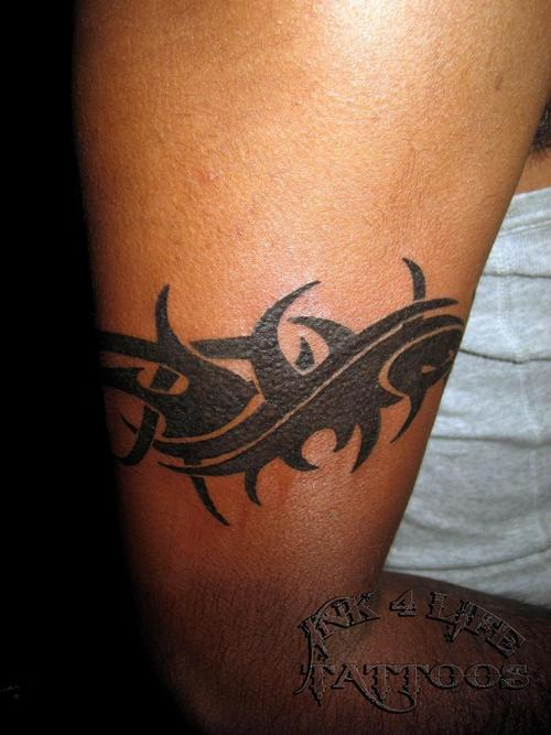 Black Ink Tribal Armband Tattoo On Muscles photo - 2