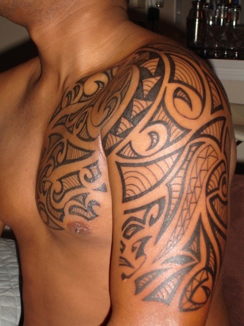 Black Ink Tribal Chest Piece Tattoo photo - 2