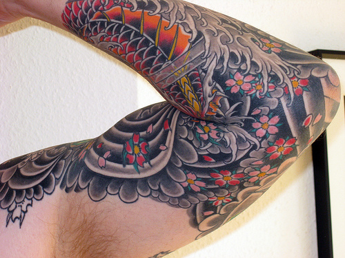 Black Ink Tribal Tattoo On Elbow For Guys photo - 2