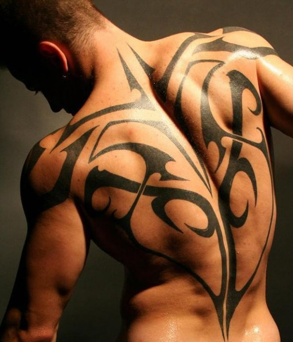 Black Ink Tribal Tattoo On Upper Arm For Guys photo - 2