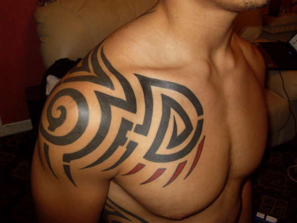 Black Ink Tribal Tattoos On Chest And Neck photo - 3