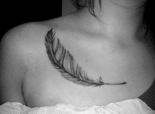 Black n White Feather Tattoo On Chest photo - 1