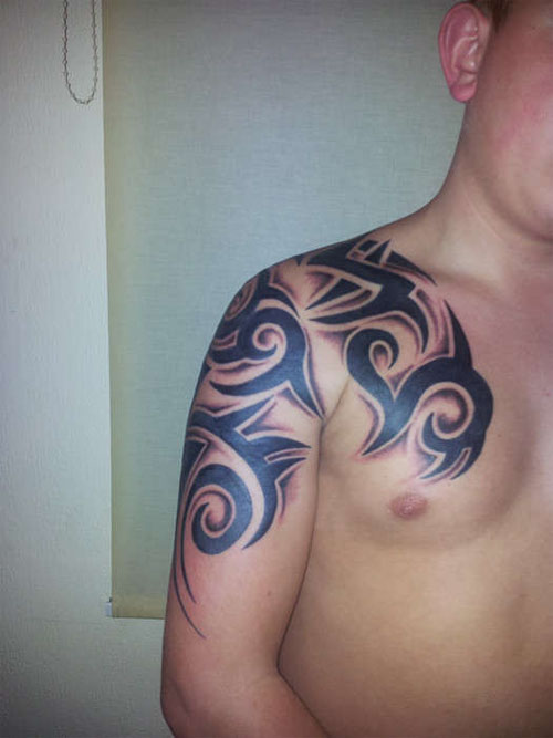 Bold Black Ink Tribal Tattoo For Chest photo - 3