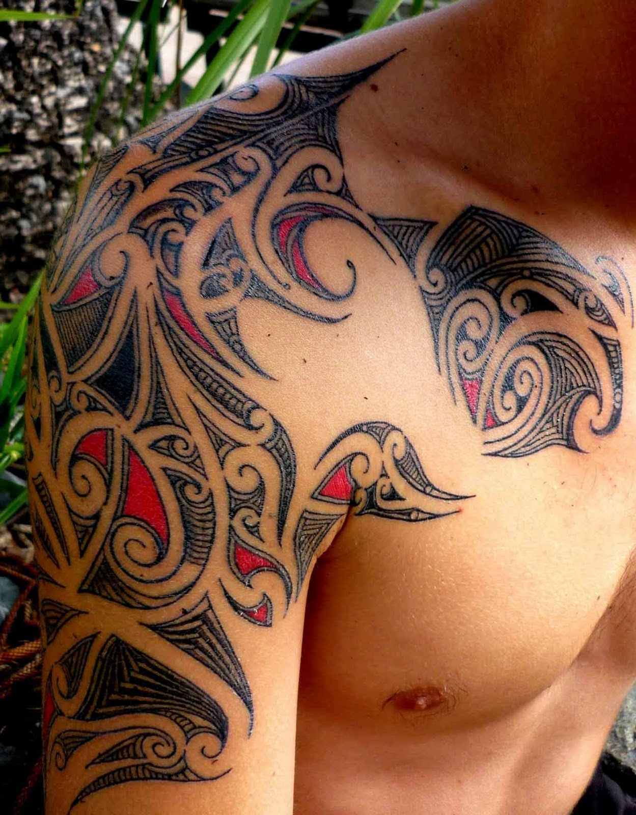 Bold Black Ink Tribal Tattoo On Biceps photo - 1