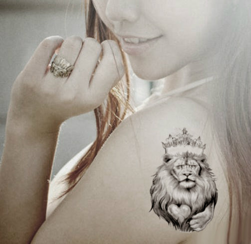 Brave Lion Tattoo On Shoulder photo - 1