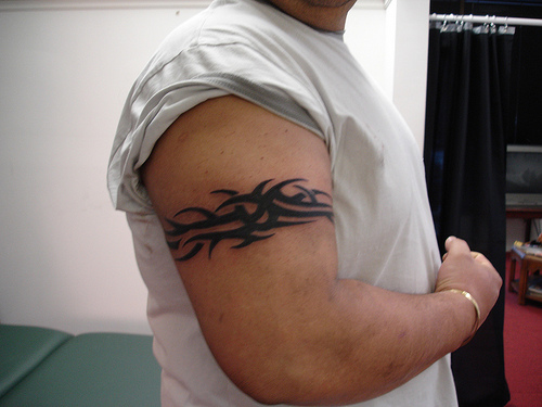 Charming Tribal Tattoo On Biceps photo - 3