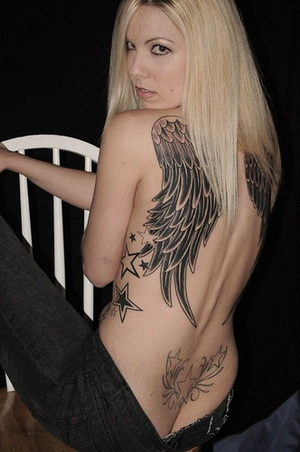 Color Ink Mexican Eagle Tattoo On Biceps photo - 1