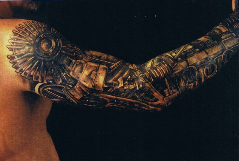 Colorful Biomechanical Tattoo On Chest For Men photo - 1