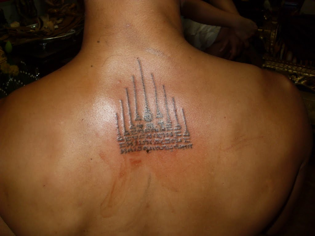 Colorful Religious Buddhist Tattoo On Upper Back photo - 1