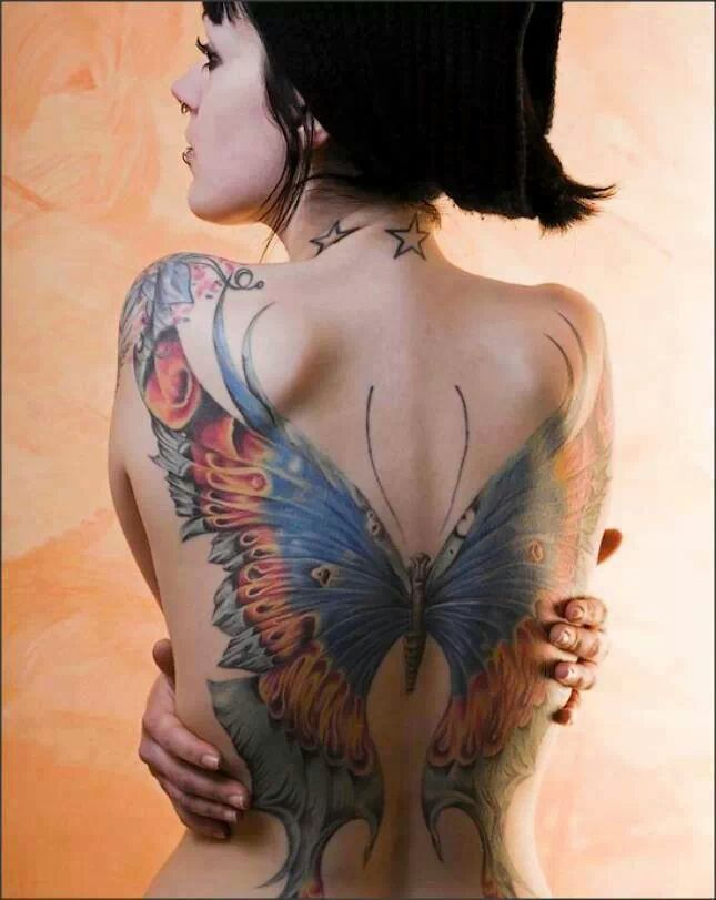 Coloured Butterfly Tattoo on Back of Girl photo - 1