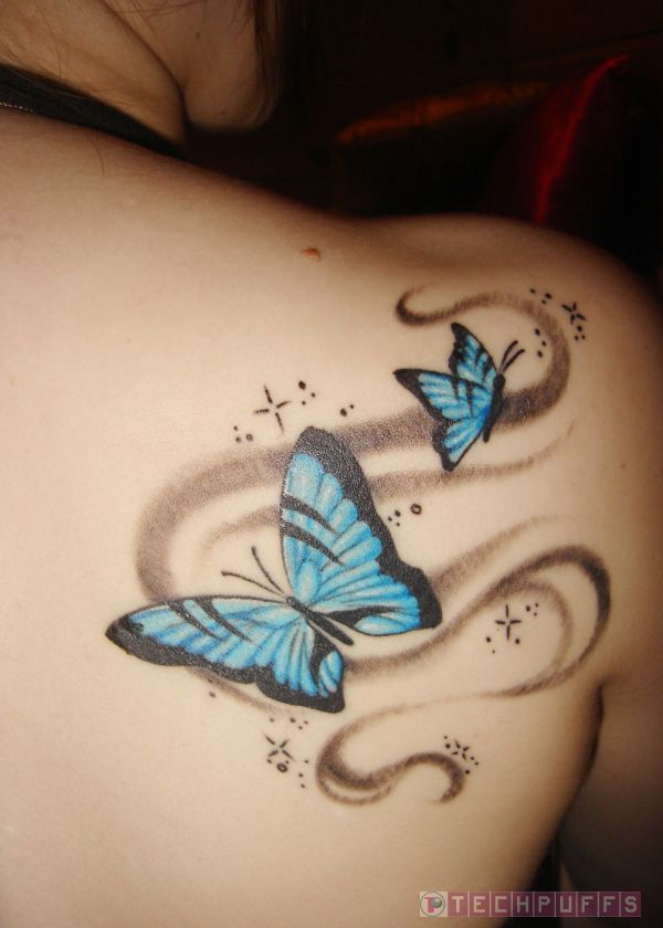 Coloured Butterfly Tattoo on Back of Girl photo - 2