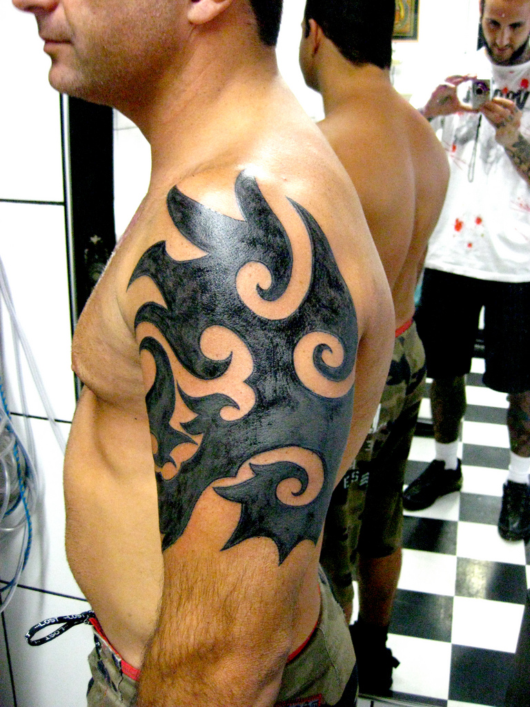 Cool Tribal Tattoos On Arm And Chest photo - 2