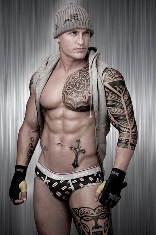 Cool Tribal Tattoos On Chest And Biceps photo - 2
