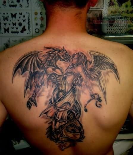 Dragon Eating Baby Angel Tattoo Design On Back photo - 1
