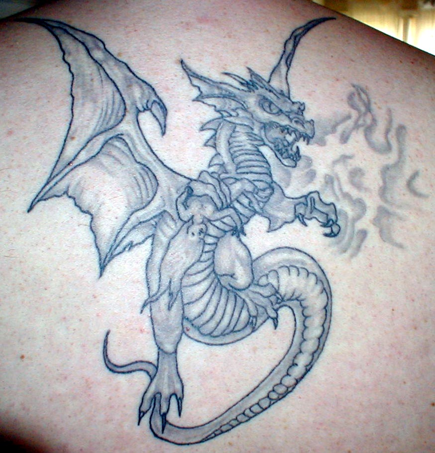 Dragon Eating Baby Angel Tattoo Design On Back photo - 3