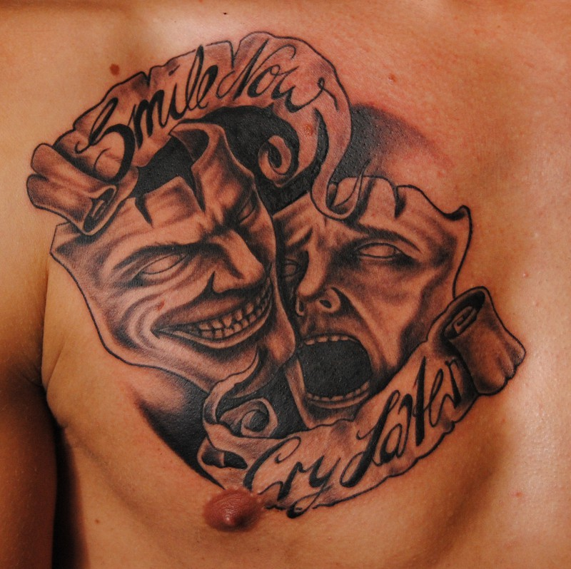 Drama Masks Tattoo On Chest photo - 1