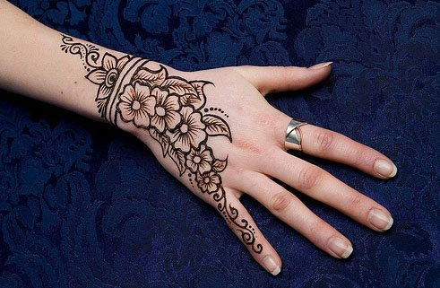 Elegant Henna Tattoo Design On Upper Back photo - 1