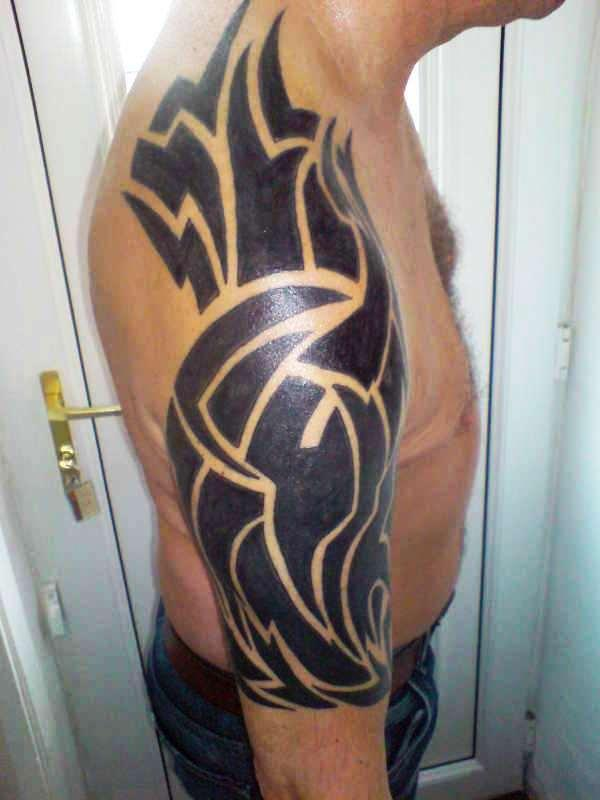 Fabulous Tribal Tattoo For Your Arm photo - 1