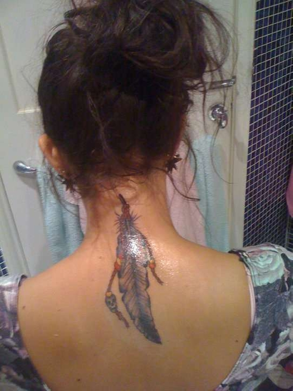 Feather Dream Catcher Tattoo On Back Of Girl photo - 1