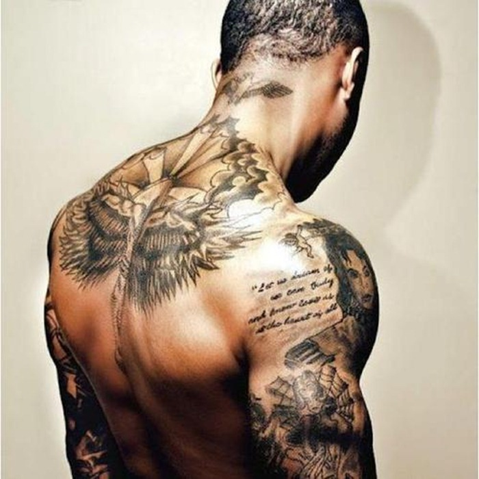 Fresh Black Ink Symbol Tattoos On Back Neck photo - 3