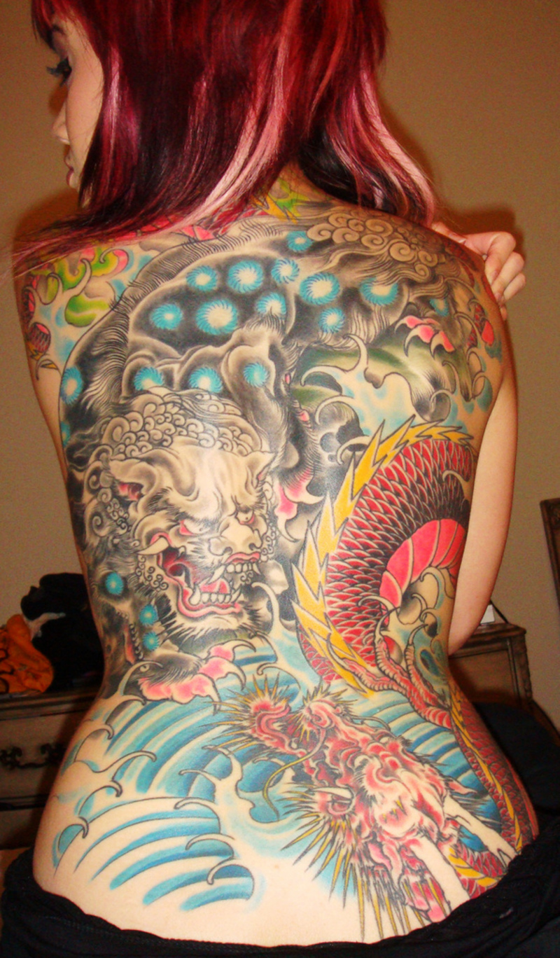 Girly Tribal Cat Tattoo On Lower Back photo - 2
