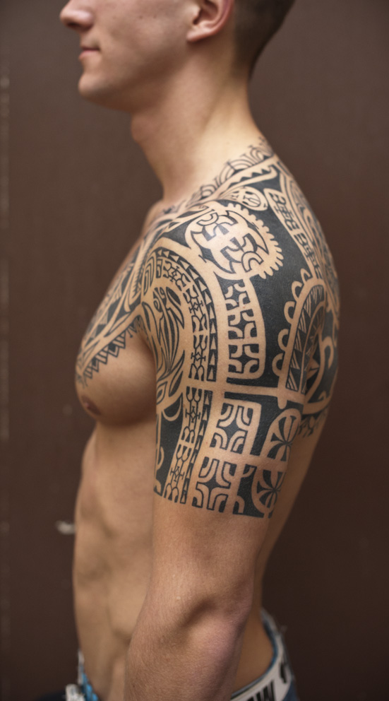 Glowing Half Sleeve Maori Tribal Tattoo photo - 3