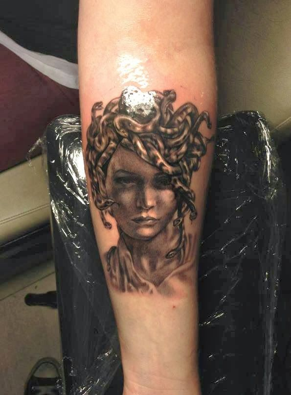 Glowing Mask Tattoo On Arm photo - 1