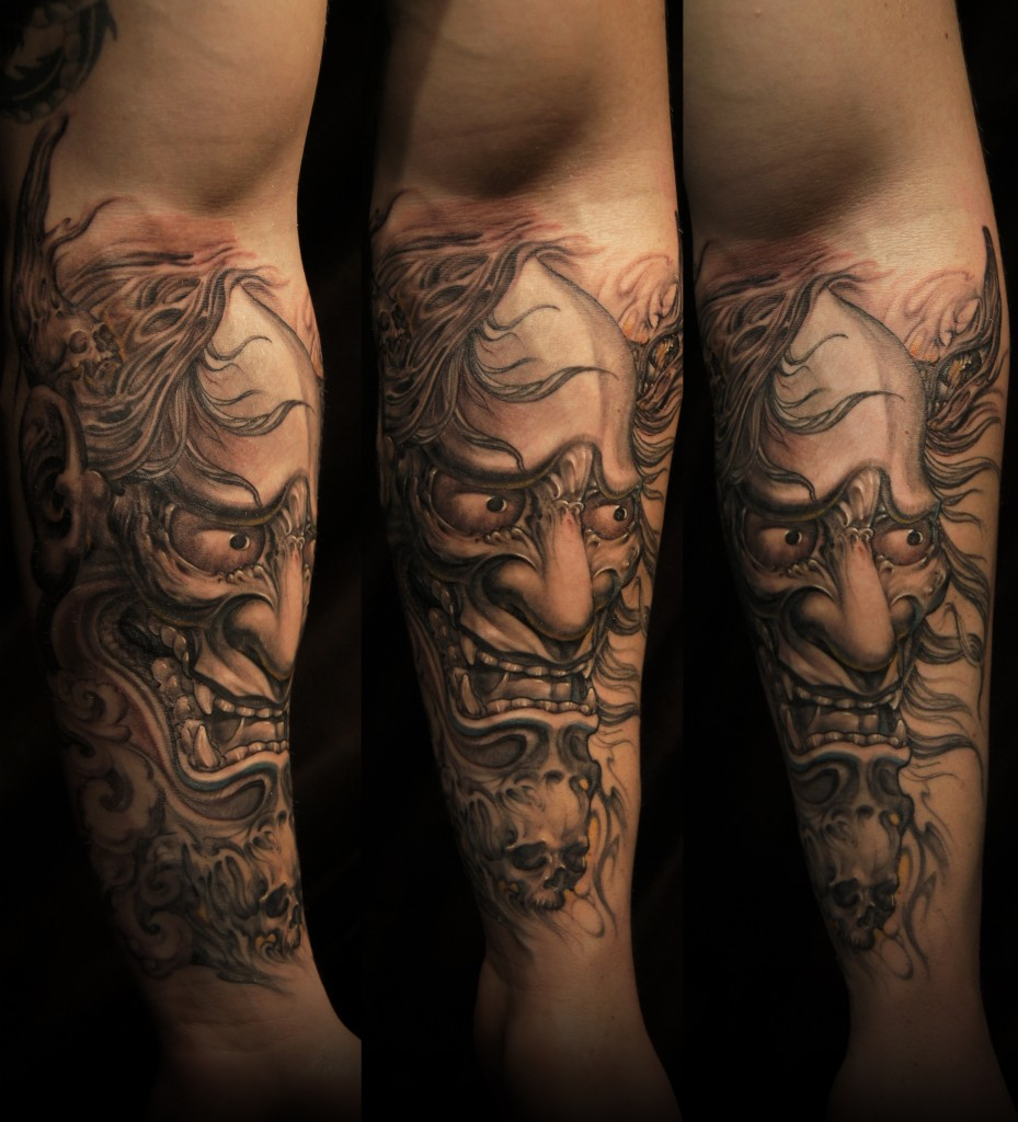 Grey Ink Oni Mask Tattoo On Chest photo - 2