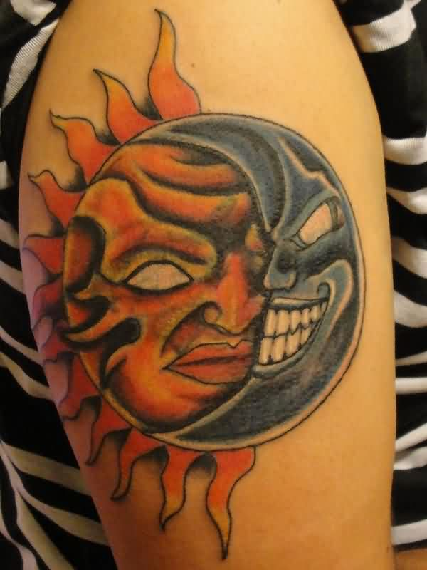 Grey Ink Sun And Moon Tattoos On Biceps photo - 2