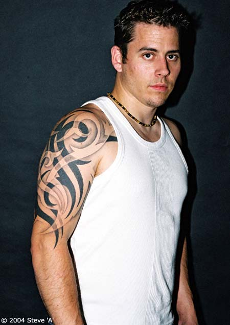 Grey Ink Tribal Tattoo For Arm photo - 1