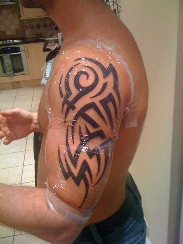 Grey Ink Tribal Tattoo For Arm photo - 2