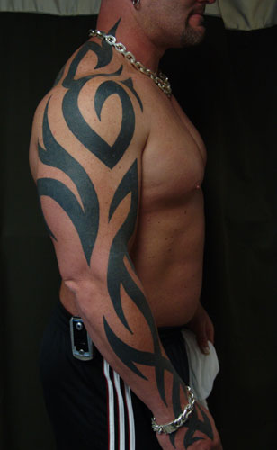 Grey Ink Tribal Tattoo On Ribs For Girls photo - 1