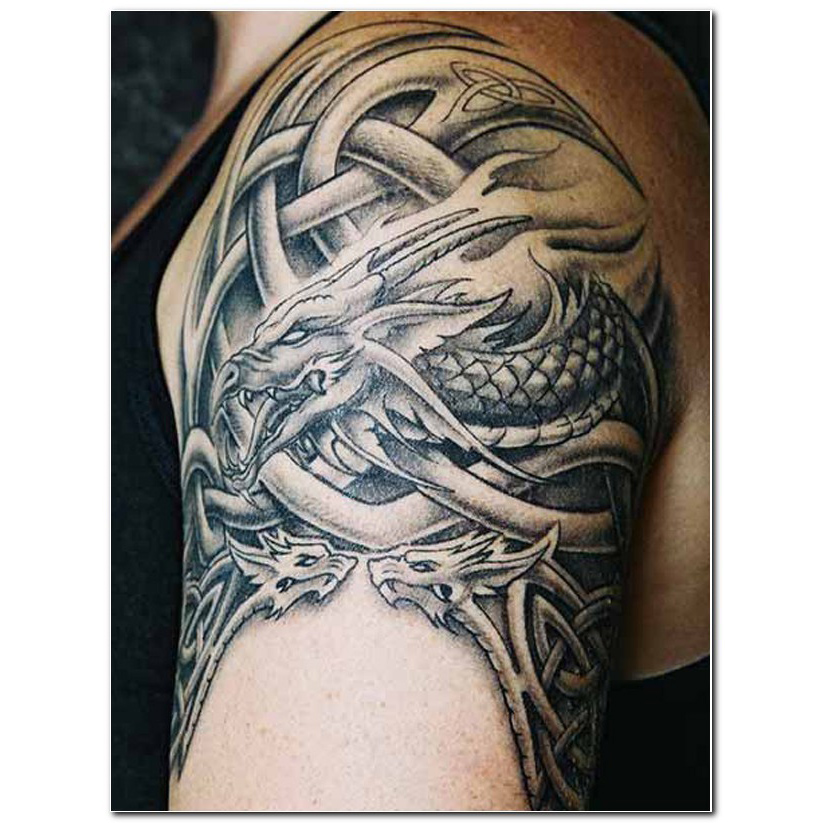 Grey Ink Tribal Tattoo On Rigth Arm photo - 1