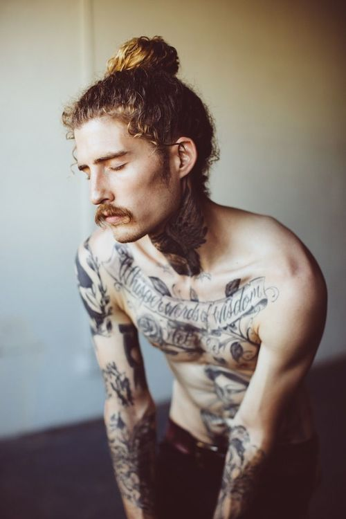 Guy With Long Hairs And Neck Tattoos photo - 1