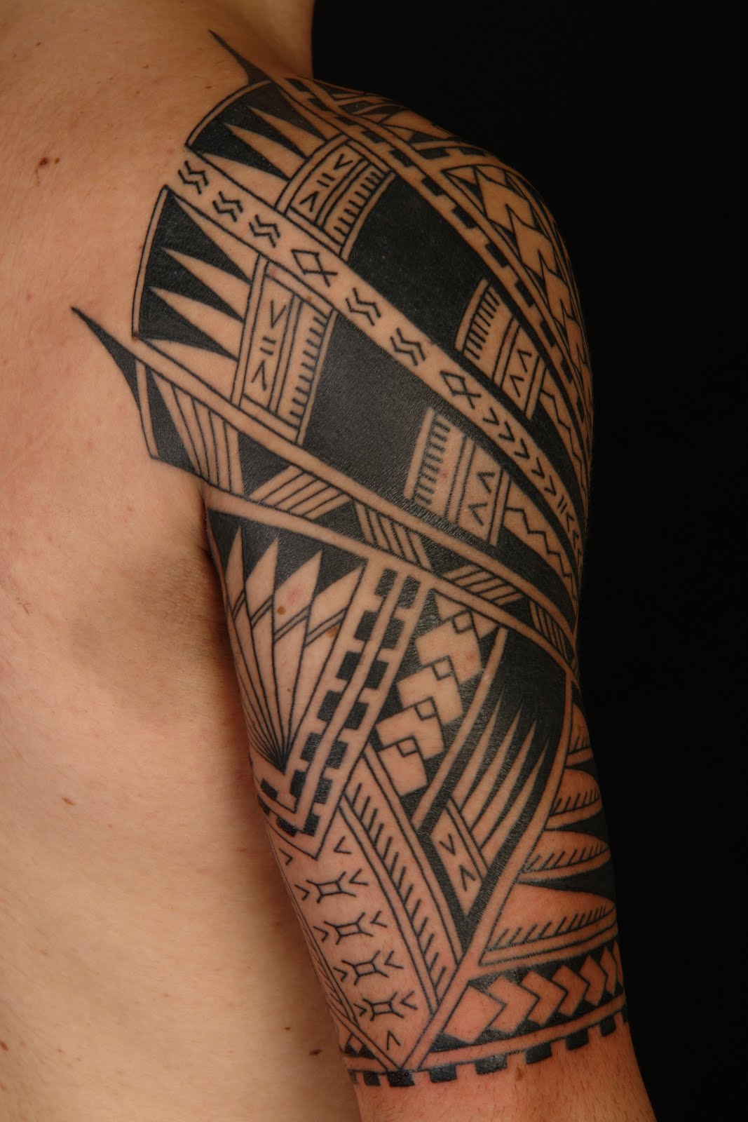 Half Sleeve Celtic Knot And Tribal Tattoos photo - 3