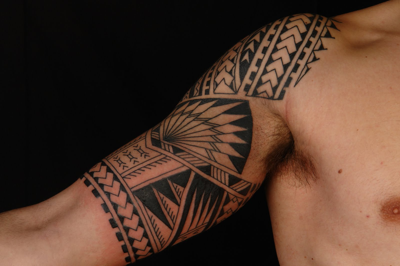 Half Sleeve Maori Tribal Tattoo photo - 2