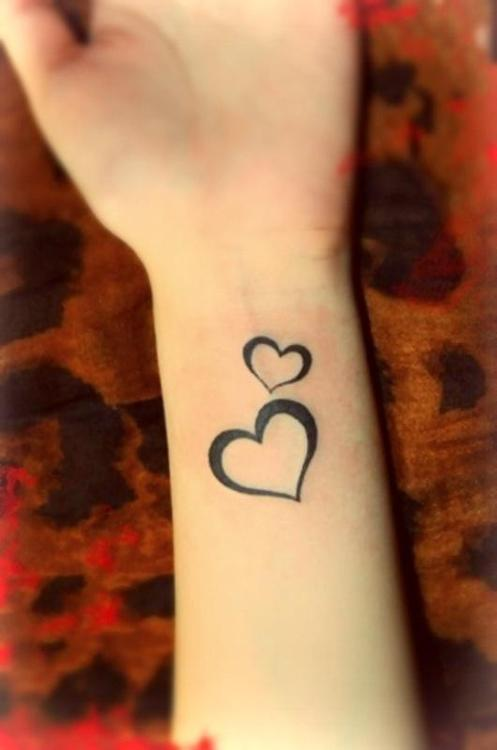 Heart And Robot Tattoos On Wrist photo - 2